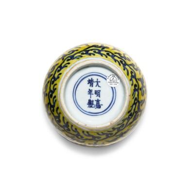 View 6. Thumbnail of Lot 83. A yellow-ground underglaze-blue 'double-gourd' vase, Mark and period of Jiajing | 明嘉靖 黃地青花纏枝蓮紋葫蘆瓶 《大明嘉靖年製》款.
