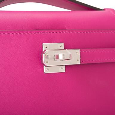 View 6. Thumbnail of Lot 15. Hermès Rose Pourpre Swift Mini Kelly Pochette.