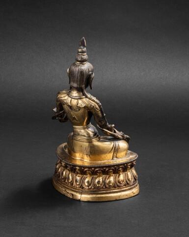 View 4. Thumbnail of Lot 48. Figure de Tara Blanche en cuivre doré repoussé Tibet, XVIIIE siècle | 西藏 十八世紀 鎏金銅白度母坐像 | A gilt-copper repoussé figure of the white Tara, Tibet 18th century.