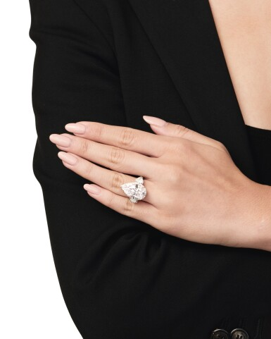 View 7. Thumbnail of Lot 134. An Exquisite Fancy Pink Diamond and Diamond Ring.