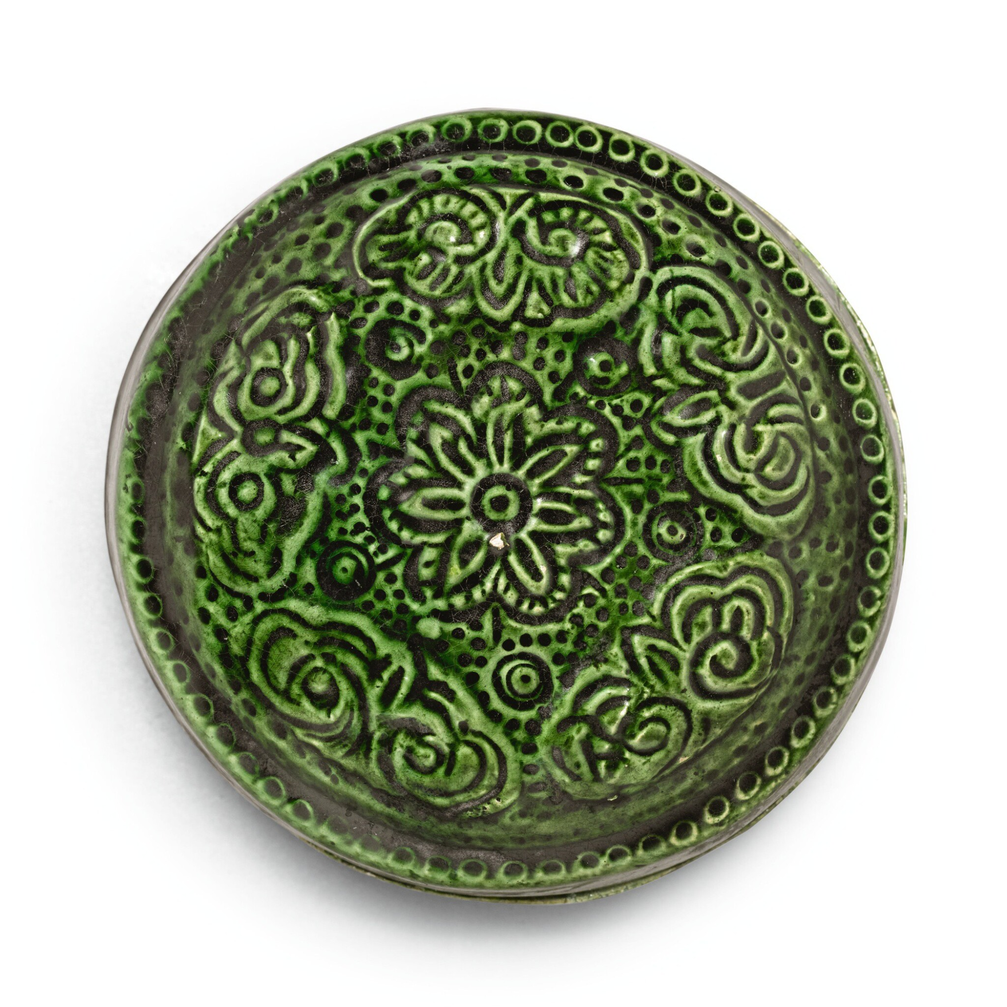 View full screen - View 1 of Lot 225. A RARE GREEN-GLAZED MOULDED AND INCISED BOX AND COVER, TANG DYNASTY | 唐 綠釉印花小蓋盒.