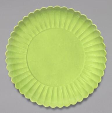 View 1. Thumbnail of Lot 6. A RARE LIME GREEN-ENAMELLED 'CHRYSANTHEMUM' DISH, YONGZHENG MARK AND PERIOD | 清雍正 青綠釉菊瓣盤 《大清雍正年製》款.