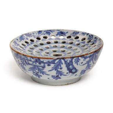 An English Delftware blue and white colander bowl, Circa 1770, London or...