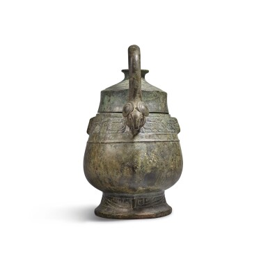 View 2. Thumbnail of Lot 6. An archaic bronze ritual wine vessel and cover (You), Western Zhou dynasty | 西周 青銅龍紋卣.