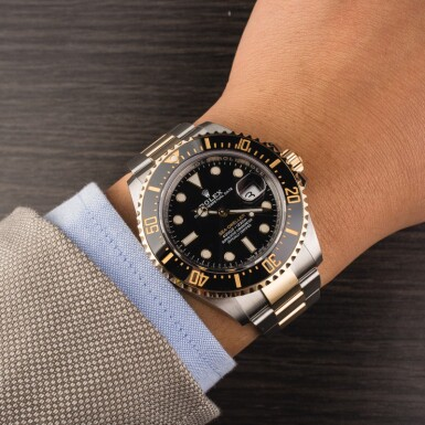 View 4. Thumbnail of Lot 5. ROLEX | Sea-Dweller, Ref. 126603, A Stainless Steel and Yellow Gold Wristwatch with Bracelet, Circa 2019.
