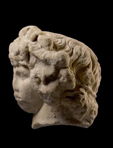 View 3. Thumbnail of Lot 251. A MONUMENTAL ROMAN MARBLE PORTRAIT HEAD OF ANTINOUS AS DIONYSOS-OSIRIS, CIRCA A.D. 130–138.