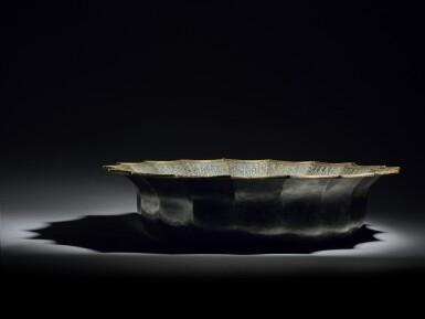 View 10. Thumbnail of Lot 74. A rare and important Khurasan silver-inlaid brass basin, probably Herat, circa 1200.