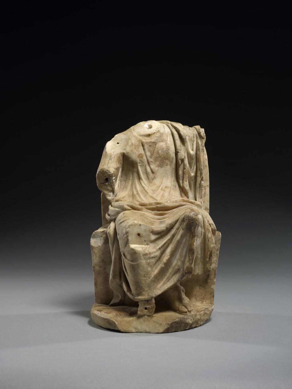 A ROMAN MARBLE FIGURE OF ZEUS OR SARAPIS, CIRCA 2ND CENTURY A.D.