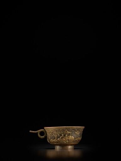View 3. Thumbnail of Lot 124. A small parcel-gilt-bronze cup, Ming dynasty, Wanli period, dated renzi year, corresponding to 1612 | 明萬曆壬子年(1612年) 銅局部鎏金松下高士圖小盃 《萬曆壬子》款.