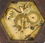 A RENAISSANCE EBONY AND GILT-BRASS CRUCIFIX CLOCK WITH ALARM, JACOB WIDENMAN, AUGSBURG, CIRCA 1620