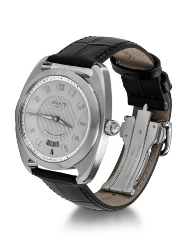 View 2. Thumbnail of Lot 99. HERMÈS   DRESSAGE L'HEURE MASQUÉE, REF DR5.810 LIMITED EDITION STAINLESS STEEL DUAL TIME WRISTWATCH WITH HIDDEN HOUR HAND CIRCA 2015.