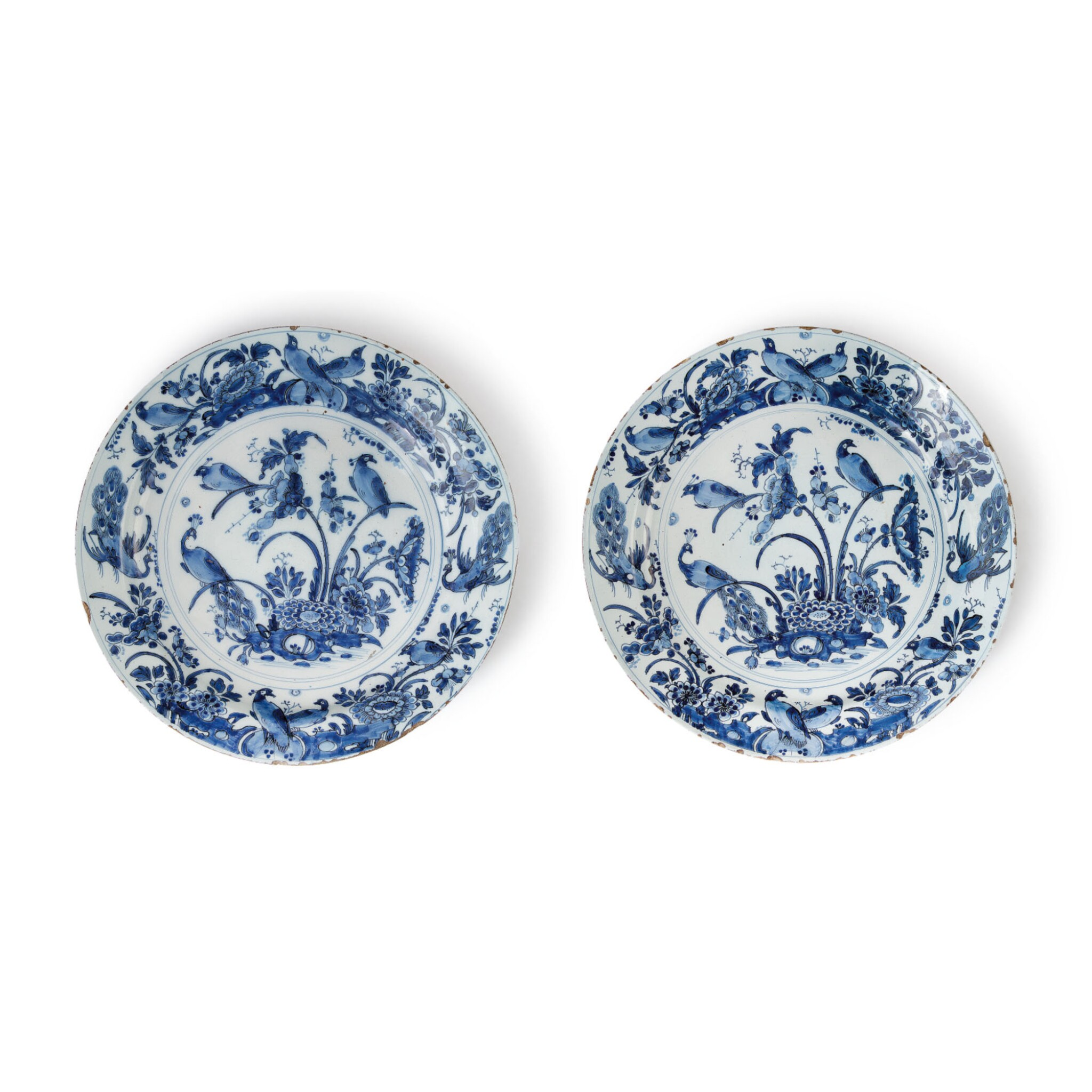 View 1 of Lot 513. A PAIR OF DUTCH DELFT BLUE AND WHITE LARGE CHARGERS, CIRCA 1700.