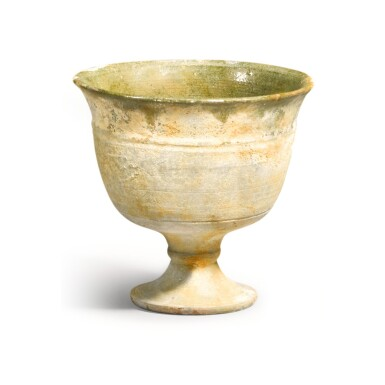 View 1. Thumbnail of Lot 217. A GREEN-GLAZED STEM CUP SUI DYNASTY | 隋 綠釉高足盃.