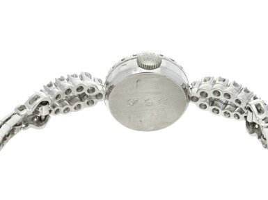 View 5. Thumbnail of Lot 157.  Retailed by Tiffany & Co.: A platinum and diamond-set bracelet watch, Circa 1950.