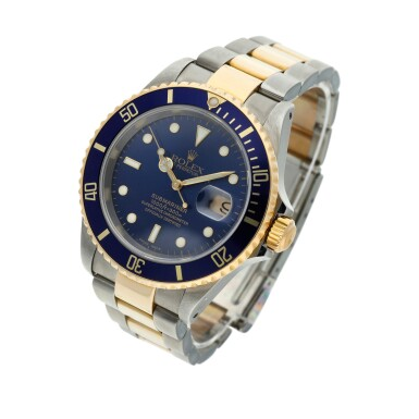 View 2. Thumbnail of Lot 10. Reference 16613 Submariner  A yellow gold and stainless steel wristwatch with date and bracelet, Circa 2002 .