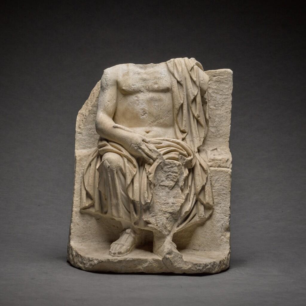 A ROMAN MARBLE STATUE OF ZEUS ENTHRONED, CIRCA 2ND CENTURY A.D.