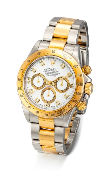 View 2. Thumbnail of Lot 853. ROLEX | COSMOGRAPH DAYTONA, REFERENCE 16523 A YELLOW GOLD, STAINLESS STEEL AND DIAMOND-SET CHRONOGRAPH WRISTWATCH WITH BRACELET, CIRCA 1999.