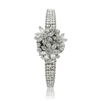 View 1. Thumbnail of Lot 96. A lady's platinum diamond set cocktail wristwatch on diamond link bracelet, Circa 1960.