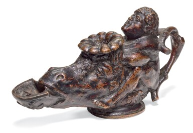 NORTHERN ITALIAN, PROBABLY PADUA, 16TH CENTURY | OIL LAMP IN THE FORM OF A BOY ASTRIDE AN ASS'S HEAD