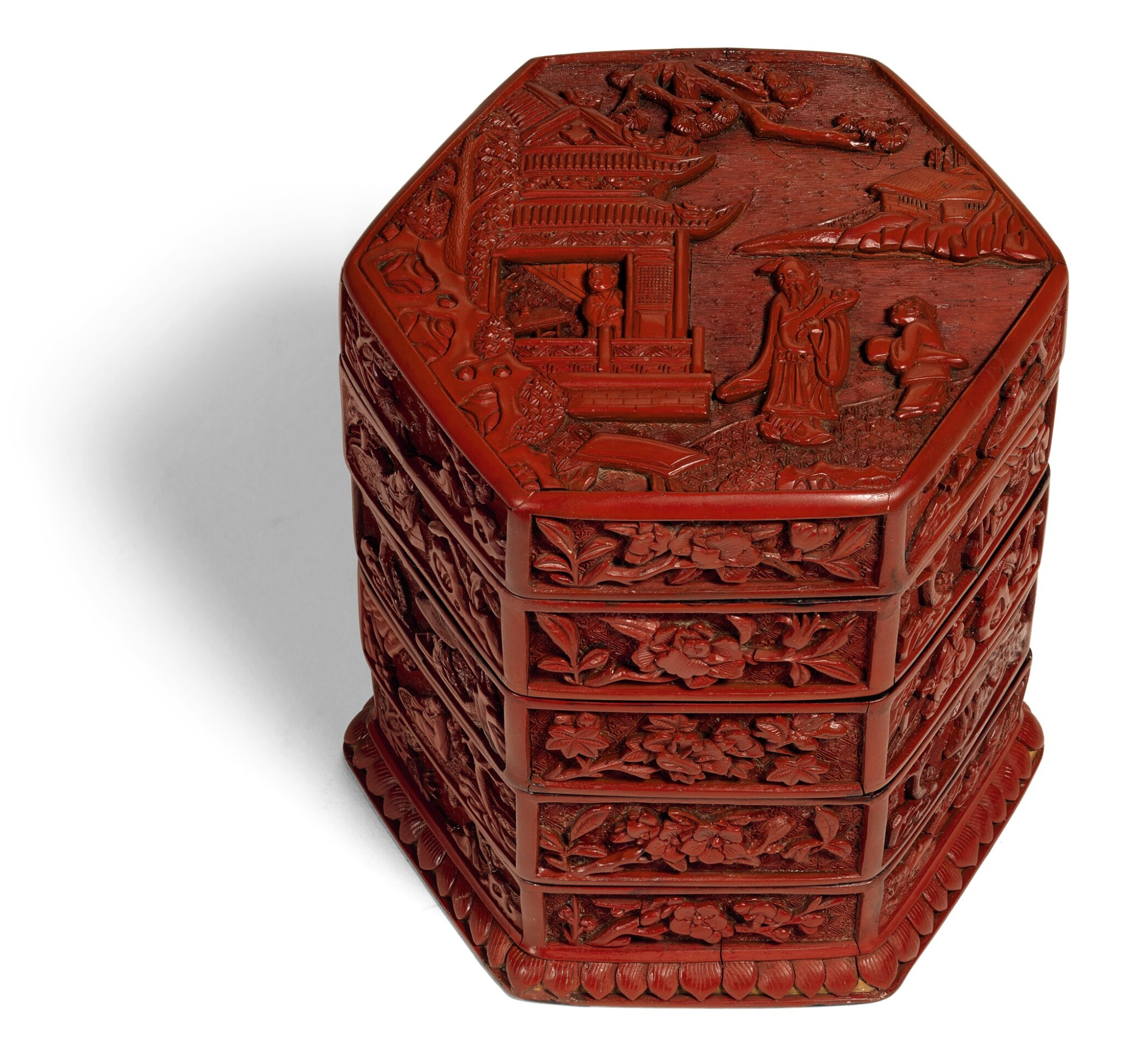 View full screen - View 1 of Lot 141. A CARVED CINNABAR LACQUER TIERED BOX AND COVER MING DYANSTY, 16TH CENTURY | 明十六世紀 剔紅庭院高士圖四層六方蓋盒.