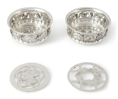 A PAIR OF DANISH SILVER GRAPEVINE PATTERN WINE COASTERS WITH PIERCED LINERS, NO. 289B, GEORG JENSEN SILVERSMITHY, COPENHAGEN, CIRCA 1919-27 AND 1930'S