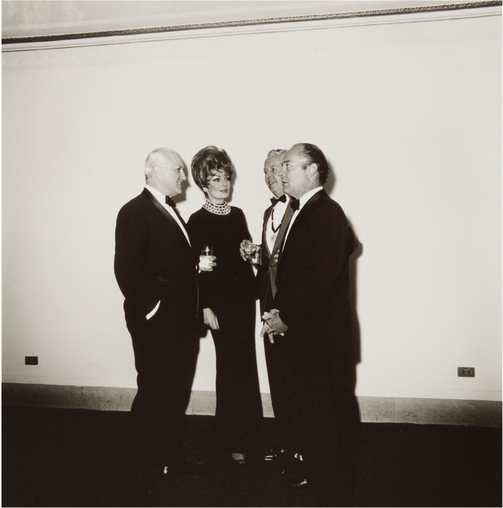 View full screen - View 1 of Lot 11. DIANE ARBUS | 'FOUR PEOPLE AT A GALLERY OPENING, N.Y.C.'.
