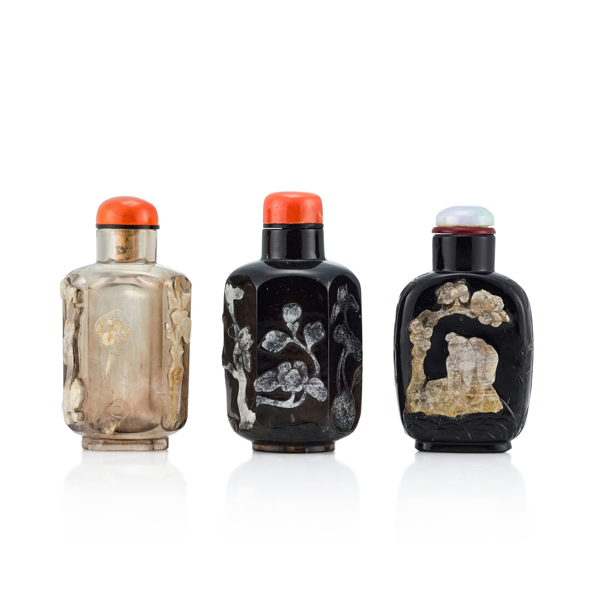 View 1 of Lot 3073. Three Carved Rock-Crystal Snuff Bottles Qing Dynasty, 19th Century | 清十九世紀 水晶巧雕鼻煙壺三件.