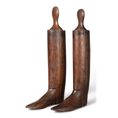 A PAIR OF STAINED WOOD BOOT STOPPERS, LATE 19TH CENTURY