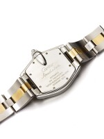 CARTIER | ROADSTER REF 2510 A STAINLESS STEEL AND YELLOW GOLD TONNEAU FORM AUTOMATIC CENTER SECONDS WRISTWATCH WITH DATE AND BRACELET CIRCA 2005