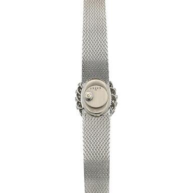 View 5. Thumbnail of Lot 158. A white gold and diamond-set bracelet watch with lapis lazuli dial, Circa 1980.