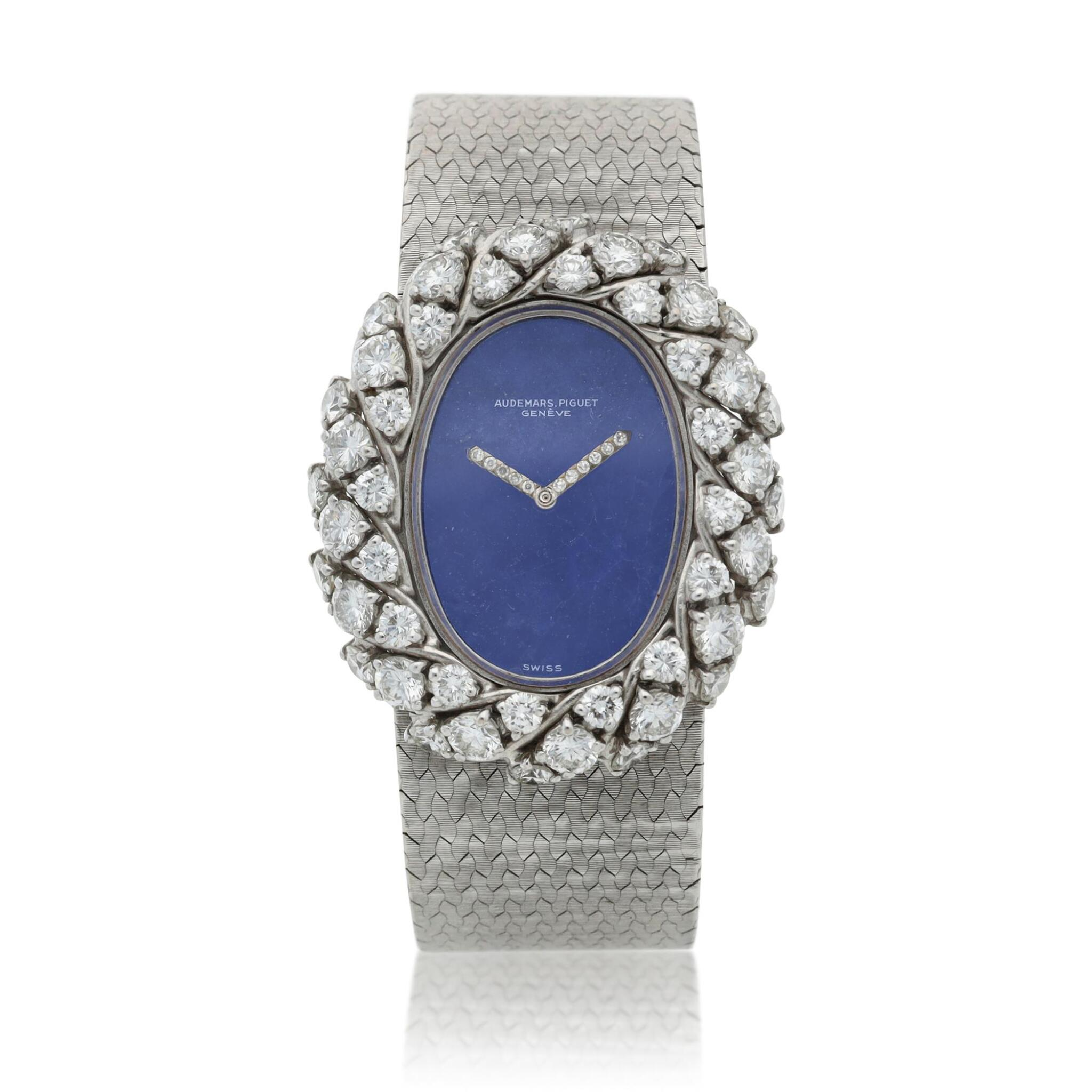 View full screen - View 1 of Lot 158. A white gold and diamond-set bracelet watch with lapis lazuli dial, Circa 1980.