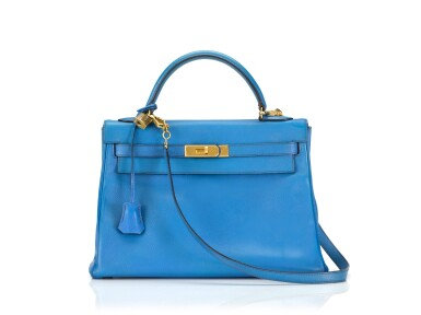View 1. Thumbnail of Lot 16. KELLY 32 RETOURNE BLUE FRANCE COLOUR IN COURCHEVEL LEATHER WITH GOLD HARDWARE. HERMÈS, 1992 .