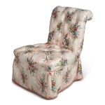 A PINK UPHOLSTERED SLIPPER CHAIR
