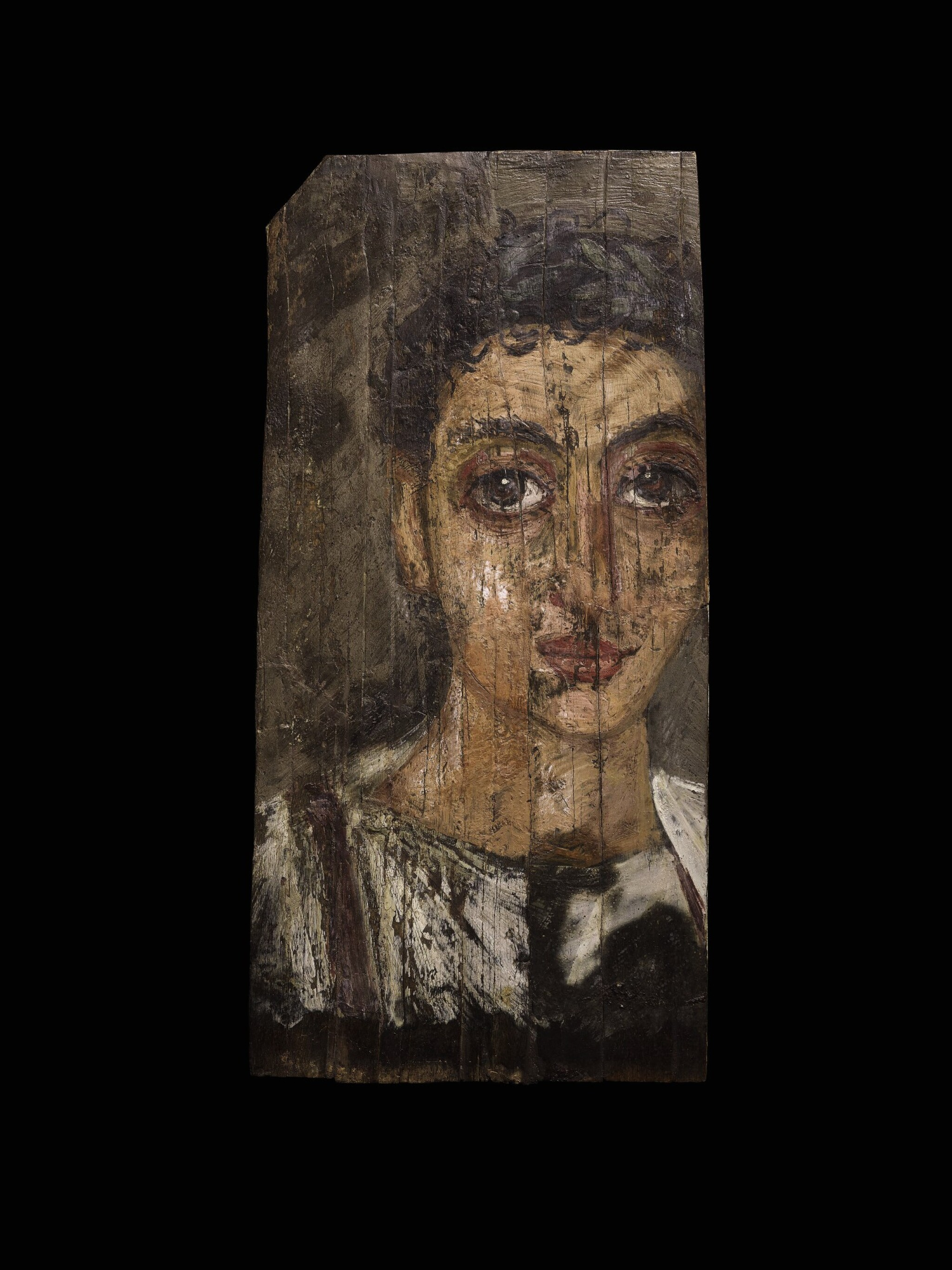 View full screen - View 1 of Lot 68. An Egyptian Encaustic on Wood Mummy Portrait of a Youth, circa late 1st Century A.D.  .