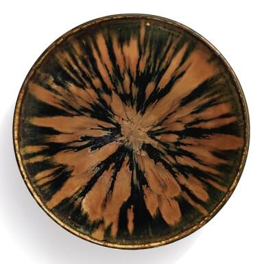 View 1. Thumbnail of Lot 101. A superb russet-splashed black-glazed bowl, Northern Song / Jin dynasty | 北宋 / 金 黑釉醬花飛斑紋笠式盞.