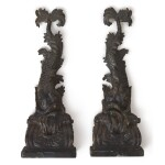 A PAIR OF CARVED EBONIZED WOOD DOLPHIN BRACKETS