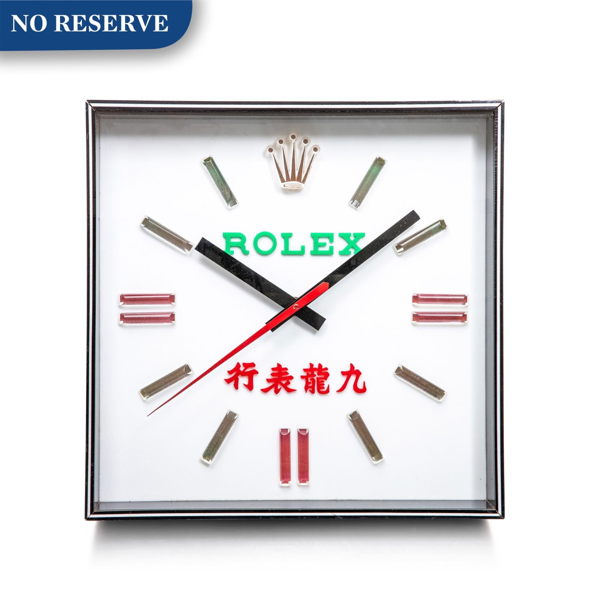 View 1 of Lot 8016. Rolex | An acrylic light box wall clock, Circa 1970 | 勞力士 | 壓克力掛牆鐘,約1970年製.