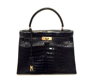 View 1. Thumbnail of Lot 743. HERMÈS | BLACK KELLY 28 IN SHINY CROCODILE WITH GOLD HARDWARE, 1962.