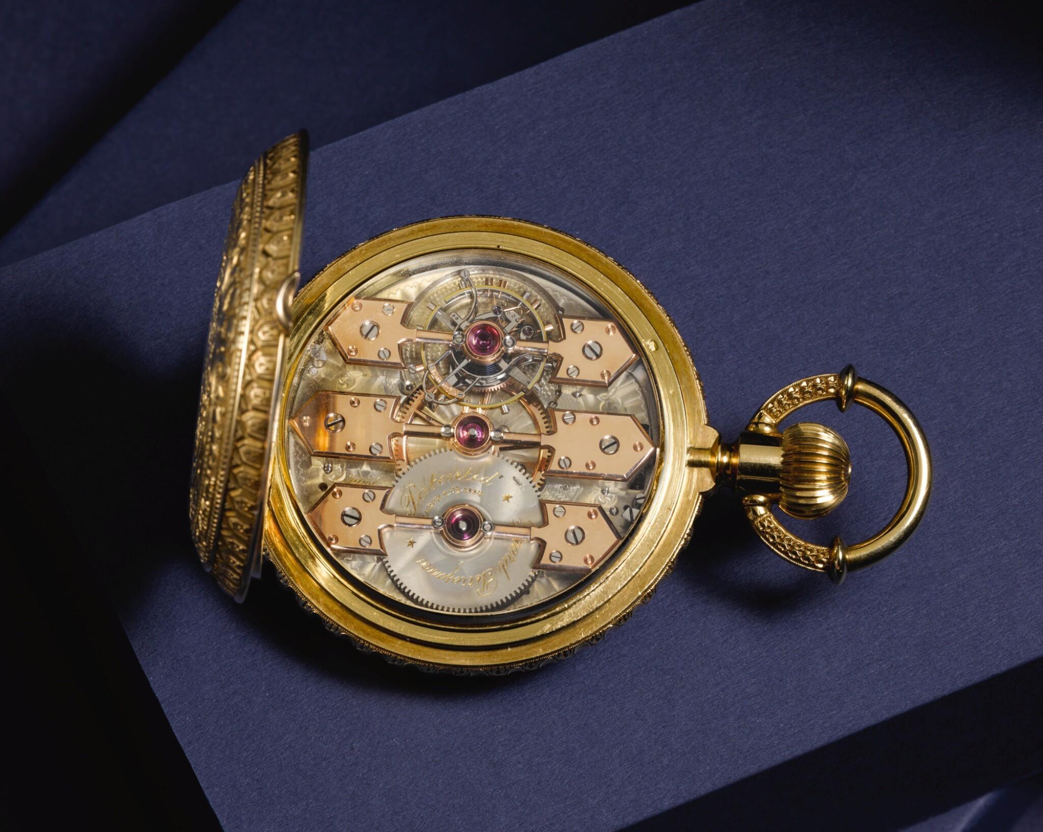 View full screen - View 1 of Lot 92. GIRARD-PERREGAUX, CHAUX-DE-FONDS [芝柏,拉紹德封] | A RARE AND HEAVY GOLD HUNTING CASED KEYLESS ONE-MINUTE TOURBILLON WATCH WITH PIVOTED DETENT CHRONOMETER ESCAPEMENT,  CIRCA 1890, THREE BRIDGE TOURBILLON [罕有黃金一分鐘陀飛輪懷錶備天文鐘擒縱系統,年份約1890,三橋陀飛輪].