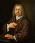 ABRAHAM CARREE   Portrait of a gentleman, half-length, seated at a table with a crucifix, his hand resting on a Bible