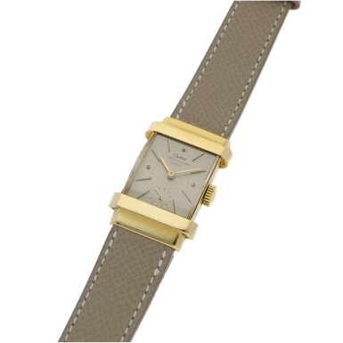View 2. Thumbnail of Lot 112. PATEK PHILIPPE | REF 1450 'TOP HAT', RETAILED BY CARTIER: A YELLOW GOLD RECTANGULAR WRISTWATCH CIRCA 1950.