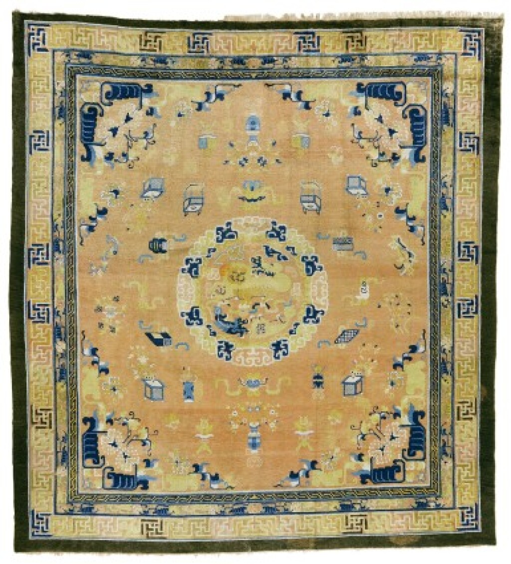 THE THYSSEN-BORNEMISZA LION-DOG AND 'HUNDRED ANTIQUES' MEDALLION CARPET, NINGHSIA, WEST CHINA, QING DYNASTY, SECOND HALF 18TH CENTURY
