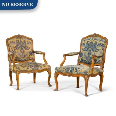 View 1. Thumbnail of Lot 79. A pair of Louis XV carved beechwood fauteuils à la reine, one mid-18th century, the other a later copy.