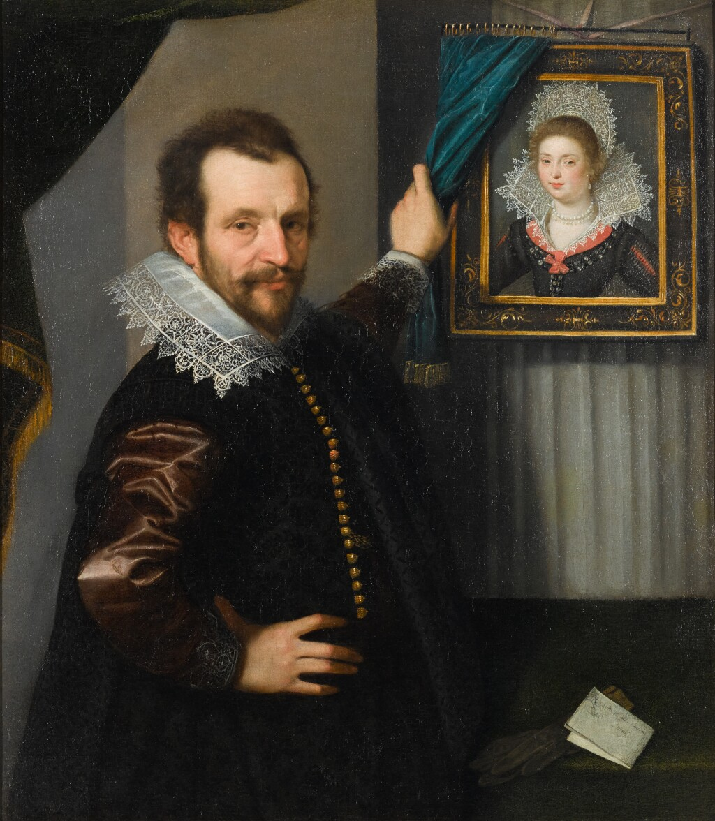 ITALO-FLEMISH SCHOOL, 17TH CENTURY | A portrait of a gentleman standing beside a framed portrait of a lady, with his right hand on his hip and a letter and gloves resting on a table