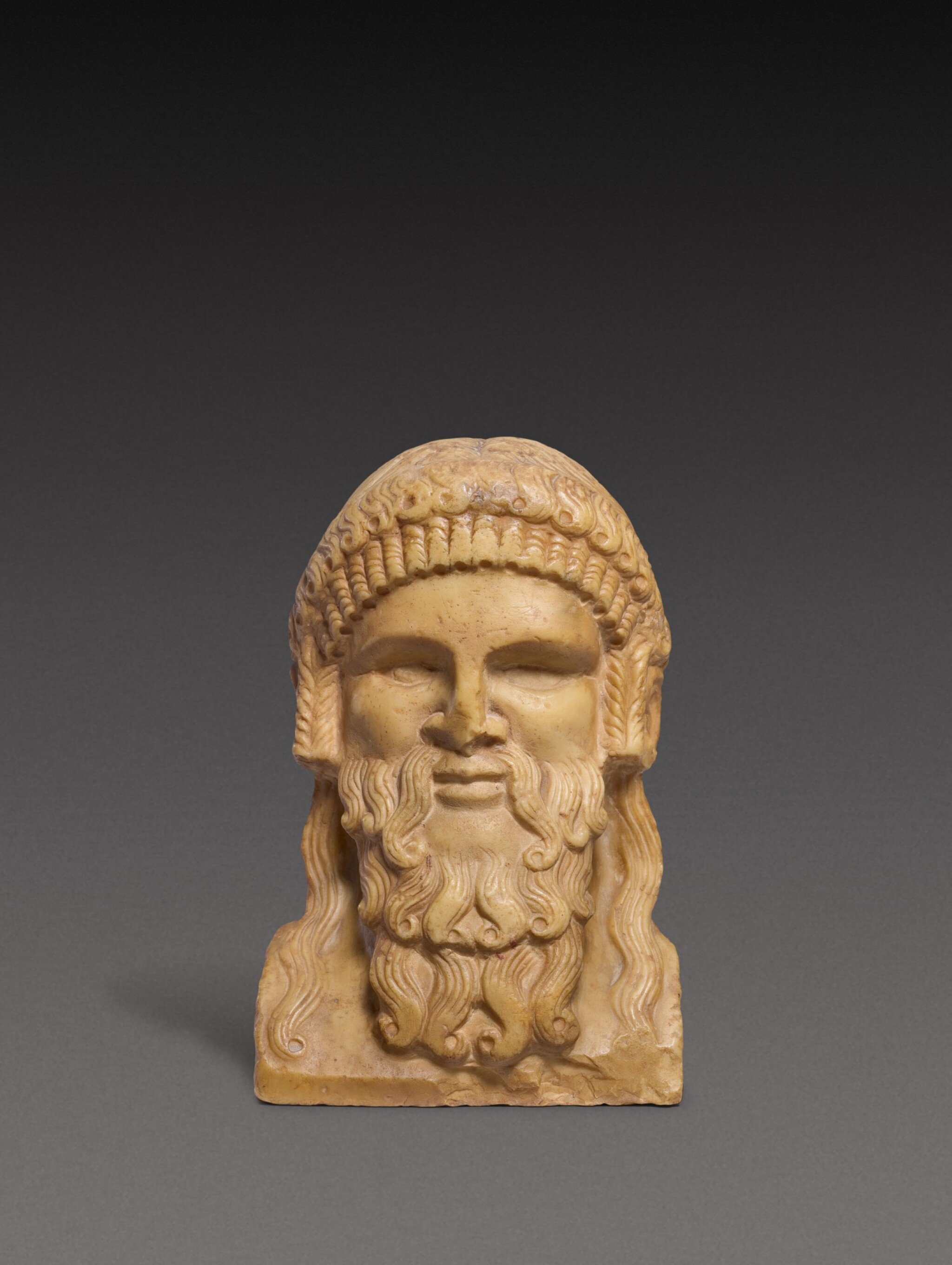 View 1 of Lot 98. A Roman Giallo Antico Marble Herm Bust of Dionysos, circa 2nd Century A.D..