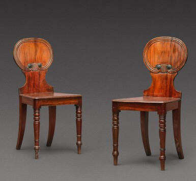 View 1. Thumbnail of Lot 169. A pair of George IV mahogany hall chairs, circa 1825.