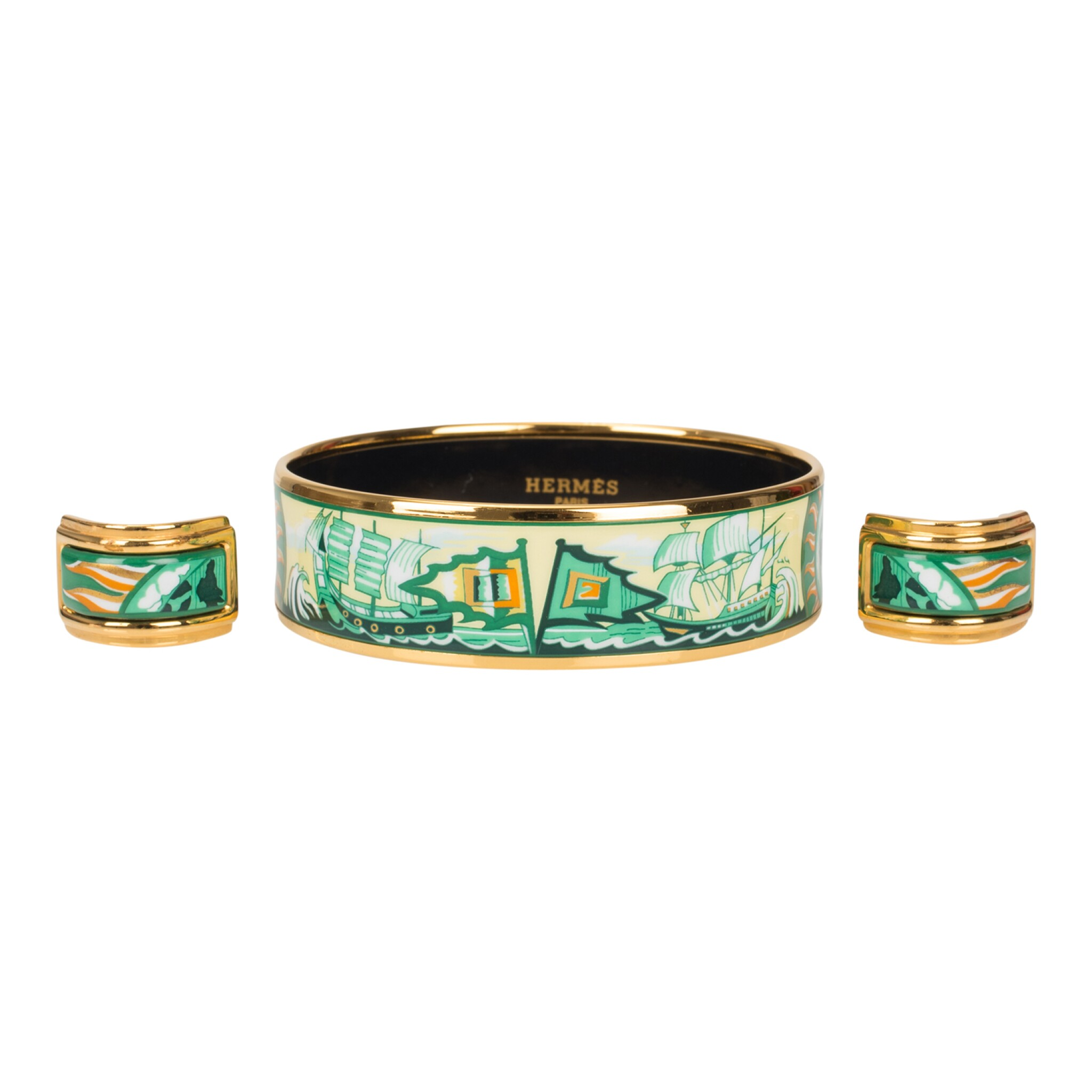 """View full screen - View 1 of Lot 98. Hermès Vintage """"Sailing Ships"""" Enamel Jewelry Set of Wide Printed Enamel Bracelet PM (65) and Clip On Enamel Earrings With Gold Plated Hardware."""