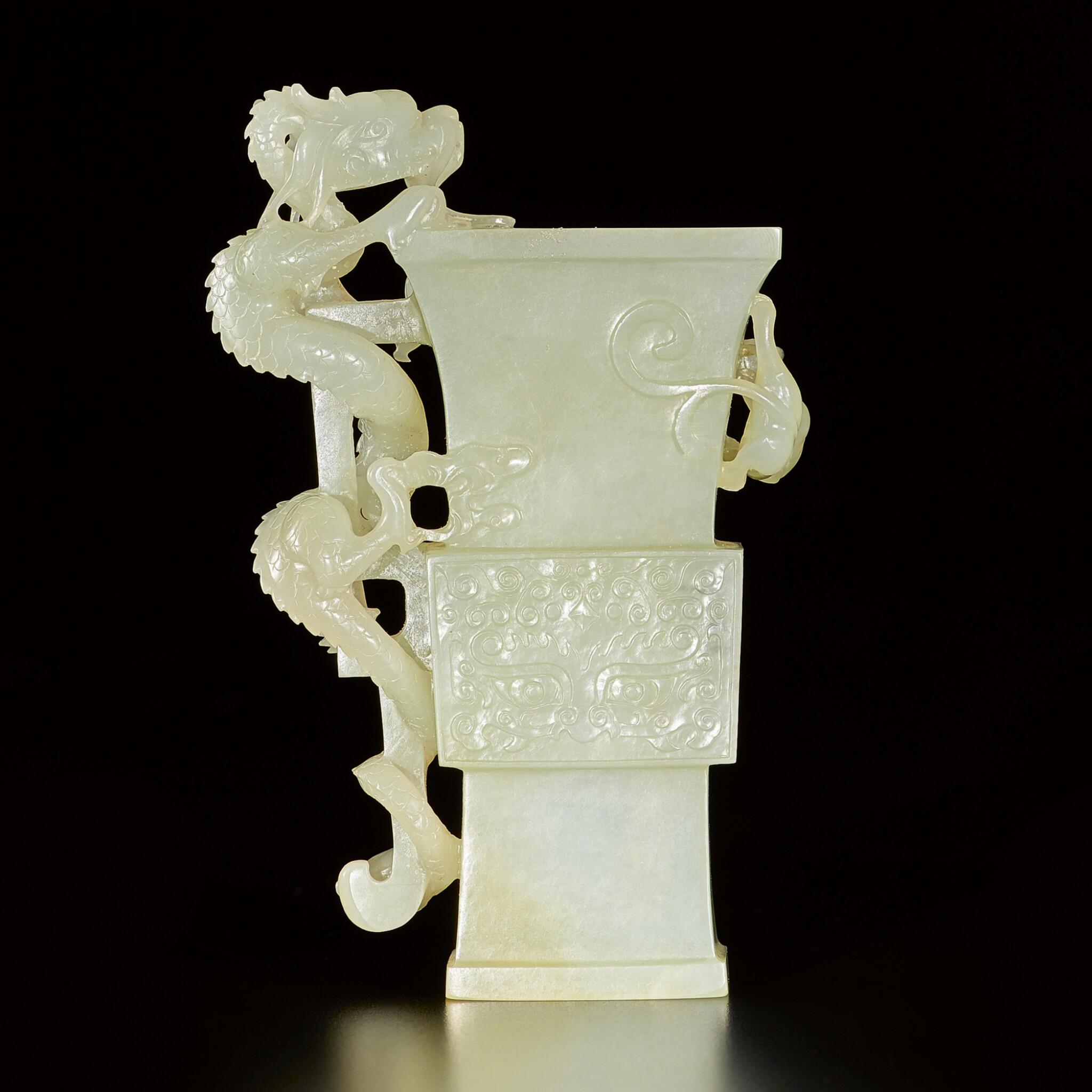 View full screen - View 1 of Lot 183. An archaisitc pale green jade 'dragon' vase, Qing dynasty, 19th century | 清十九世紀 青玉雕仿古饕餮螭龍紋尊.