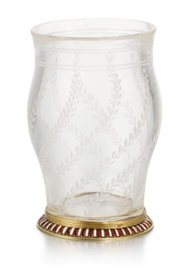 View 1. Thumbnail of Lot 42. A Fabergé en plein enamel gold-mounted rock crystal vase, workmaster Michael Perchin, St Petersburg, 1899-1903.