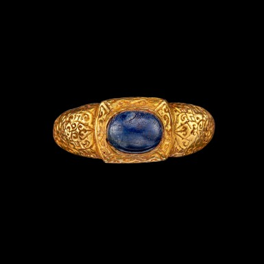 View 1. Thumbnail of Lot 1073. A gold and cabochon sapphire repoussé ring Champa, 14th century | 十四世紀 占城 金嵌藍寶石戒指.
